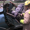 4-29-00---Michael McKinley, with Nash Texas volunteer fire department uses a device while raising the dash compartment away from a victim while training with jaws of life and other rescue tools. Kevin GReen