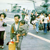 South Vietnamese refugees unload from transport helicopters onto a U.S. carrier.