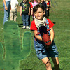 Pine Tree Primary School held Texas Day Celebration Friday.  Kindergartner Jessica Nelson races toward the catcus with her stick horse as she and classmates participate in the stick horse race contest.  by DARLENE-4-28-00