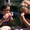 08-31-00--Kilgore College cheerleaders, Amanda Smith, left, and Ashley Wilson, enjoy sloppy barbecue sandwiches during KC kick-off day Thursday. By Kitta Dory