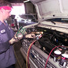 8-31-00---Robert White, with Longview Welding and Radiator adds freon to a vehicle Thursday afternoon in Longview. Kevin GReen