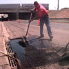 8-30-00---Steven Gonzalez, with the City of Longview streets dept. spreads asphalt while working on Mobberly street Wednesday afternoon in Longview. Kevin Green