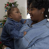 12-22-00--Marie Crayton, right, holds her daughter Jordon, 17 months, at their home near Hallsville. Kevin green