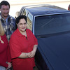 12-22-00---Doug and Traci Smith, left, owners of Doug's Paint and Body in White Oak, stand with Sherry Salazar and her car they fixed after the storm in Longview. Kevin Green