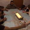 12-21-00---Eight days without any electricity had the Montgomery family thanking and praising the Lord once their power finally arrived Thursday at 3 PM.  (from left) Davin (18), Christian (6), Ashanti (7), Johnny (dad), Jayme (11) and Vivian (mom) gather around the dinner table and pray before they eat their first homecooked meal in more than a week.  Brian Jenkins