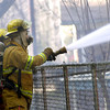 Longview firefighters battle a fire Thurday afternoon that destroyed a Caldwell Street home and left a family of five homeless for the holidays. Les Hassell