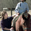 2-28-00---Windridge Equestrian Theraprutic Center's Dawn Searcy works with ten year old Maddison Cotton Monday afternoon at Windridge in Upshur County. Kevin Green