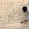 2-29-00---Ezekiel Alfaro, with Garrett Memorials of Longview, uses a rubber mallot to secure the rubber stenciling to the brick in preparation for sand-blasting Tuesday afternoon at Heritage Plaza in downtown Longview. Kevin Green