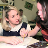 2-28-00---Jodie Jones works with student Jessica Wright Monday morning at LHS in Longveiw. Kevin GReen