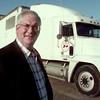 2/29/00---Mitch Henderson stands outside Henderson Trucking in Longview. bahram mark sobhani