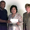 2-29-00---Oscar Polk, left, with Eastman, presents a check for 1,000 to Ana Walker, center and Celia Elkins, right, president of board of directors with the LISD Foundation Tuesdat at LNJ. Kevin Green