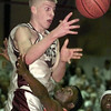 2/29/00---White Oak post David Mitchell (40) is fouled by Queen City player Tony Pace (33) in the second half of their game in Marshall. bahram mark sobhani