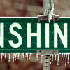 1/28/00---Icicles cling onto a streetsign Friday in Longview after two straight days of freezing temperatures. bahram mark sobhani