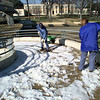 Kilgore College grounds department crew members George Holt,left, and Lora Cuthbertson are hard at work on clearing ice from the walkover so students can ressume use Monday morning.  The walkover has been closed due to dangerous ice .  by DARLENE-1-31-00