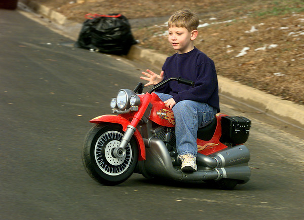 Clear roadways made it possible for five year-old Jake Rhodes to take a spin on his battery operated Harley Davidson motorcycle.  Jake is the son of Trey and Trina Rhodes of north Longview.   by DARLENE-1-31-00