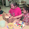 7-29-00---Haydee' Youngblood, center, volunteers while working with Eric Rodriguez,5, left, and Edith Zavaleta, right, at Asbury House in Longview. Kevin GReen