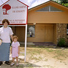 Leslie Kay Caffey and daughter 4 year old Tabitha in front of thier new home during the Kilgore Habitat For Humanity Dedication ceremony. Obie Le Blanc