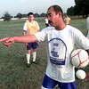 7-24-00---Andre Lo works with his players during soccer practice Tuesday evening at the fields in Longview. Kevin GReen