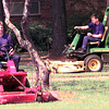 3-30-00---Ryan Ward, left, and Jeremy Flanagan, right, mow the lawns at the Ambassor College campus as staff members of A.L.E.R.T. move into the locations. Kevin GReen