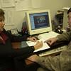 11-22-00---Suzanne Bickham, left, works with web designer Henry Sandfur, right, at Expert Computing. Kevin green