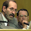 TNRCC Commissioner Ralph Marquez, right, listens as attorney for NETAC Jim Mathews of Austin speaks during the North East Texas Air Care meeting Tuesday November 28, 2000 in the Longview City Council Chambers. Les Hassell