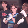 0-29-00---Longview Hgih School students Dennis Quinn, left, Crystal Andrews, center and Vincent Stansell, right,  students in the American Sign Language class sign the Star Spangled Banner song prior to Friday night's game at Lobo Stadium in Longview. Keivn GReen