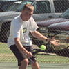 Longview High School senior Bryan Parker uses a backhand in a return during a match against a  Midway player Saturday afternoon.  byDARLENE-9-30-00