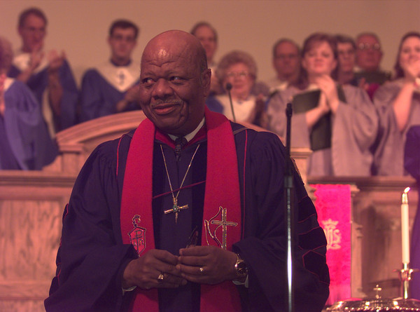 Bishop Alfred L. Norris of the Texas Conference Of the United Methodist Church recieves applause after the installation ceremonies held at First United Methoidst Church Saturday afternoon.  by DARLENE-9-30-00
