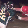 9-29-00---Longview's #22 is brought down by Ruston's #65 during play Friday night at Lobo Stadium in Longview. Kevin Green
