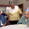 Barbara Wilder, left, a friend and Joy Wolf , center, daughter of Leonora Kleban, right, visit as she clelebrates her 103rd birthday Tuesday August 13, 2001 at Wispering Pines Nursing Home in Longview. Keivn green