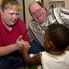 Tanya and George Killebrew with the Buckner foster-care program play with their foster child at their home Wednesday August 29, 2001 in White Oak. Kevin green