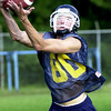 8-13-01----Pine Tree's Kyle Moseley catches a pass during practice. Kevin green