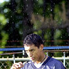 8-13-01----Pine Tree's Ephruim Armas, a senior gets a drink while standing in a shower to cool off during the first day of football practice at Pine Tree High School Monday afternoon in Longview. Kevin green