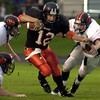 Gladewater's #12 runs with the ball Friday August 31, 2001 against Gilmer. Darlene