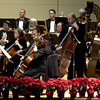 Members of te Longview Symphony Orchestra perform duirng a show Saturday December 29, 2001 at T.G. Field Auditorium in Longview. Kevin Green