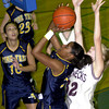 Pine Tree's #32, left, is fouled by White Oak's #32, right, during the game at Pine Tree Gym in Longview. Kevin green