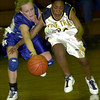 Spring Hill's #20, left, and Pine Tree's #30, right, battle of ra loose ball during the game Saturday December 29, 2001 in Longview. Kevin Green