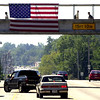 Kilgore College students walk over U. S. 259 on the crosswalk as an American Flag hangs over the highway Wednesday September 12, 2001 in Kilgore. Kevin green