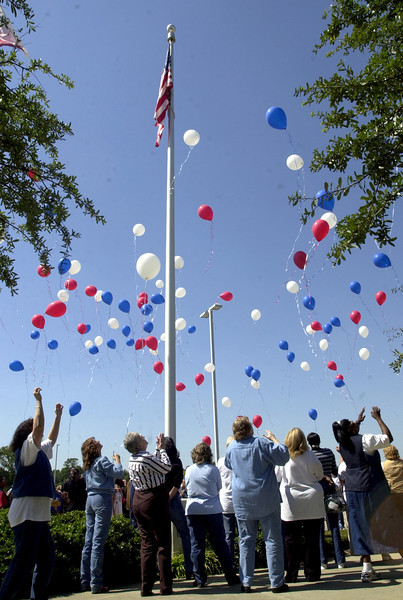 Neiman Marcus employees release balloons Friday September 28, 2001 at their offices in Longview. Keivn Green
