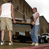 Brian Fowler, left,a LeTourneau University student and Paul Jobe, right, of Kilgore, moves church pews into the new location of the curch Saturday September 1, 2001 at the Longview Mall. Kevin green