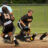Pittsburg's #1 slides safely into third as Gilmer's #30 fails to make the tag during Tuesday's April 30, 2002 game. Les Hassell