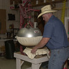 5-20-02 ----- Mike Helms puts a hat into a press in his custom hat shop at C&C Western Wear.  JUSTIN BAKER