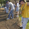 LeTourneau University students started early Saturday morning in participation in their volunteer project Longview Blitz.  Michael Lewis,left, and Lily Miller, right,  spread top soil where scrubs and trees will be planted at Longview City Hall.  by DARLENE-8-31-01