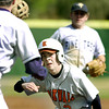 Rockwall's #5 gets caught between first and second during Thursday's February 28, 2002 game against the Pine Tree Pirates at Driller Park in Kilgore. Les Hassell