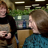 hairsylist Sherrie Patterson, left, holds ten inches of Stacy George's hair, right, the 16 year old daughter of Billy and Carol Lee, of Longview, after she cut the hair to donate to Locks of Love Thursday January 31, 2002 at Rumours Hair Salon in Longview. Kevin green