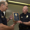 Police Cheff A.J. Keys right hands Sgt. Mike Downs a plaque during his retirement reception at the Longview Police Department Wenesday July 31,2002.Ricardo B.Brazziell