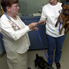 Celia Robinson,Left, a represenative from the Kennel Club donates a portion of the proceeds from the Kennel Club AKC Licensed All Breed the Dog Show $1,900  to Loretta Kanniard of the Gregg County Humane Society WenesdayJuly 31,2002.Ricardo B.Brazziell