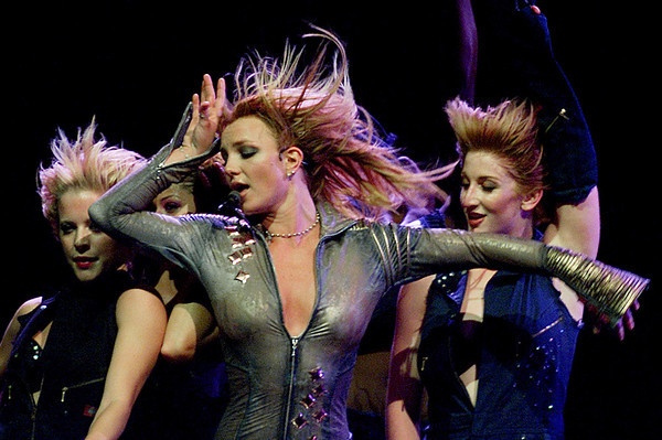Britney Spears, center, performs in Dallas, Monday, July 22, 2002. (AP Photo/Fort Worth Star-Telegram, Paul Moseley)