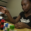 Kimberly Buchanan 14 a student at the Longview High school Summer Academy  build blocks in Algebra expression's.Wenesday July 31,2002.Ricardo B.Brazziell