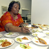 Asbury House Early Child Enrichment Center's cook Bernice Phillips prepares lunch at the dau care Wednesday July 31, 2002 in Longview. KeviN Green